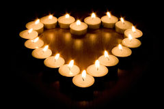 Candle heart Stock Images