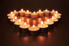 Candle Heart. Soft focus heart of candles on gold with all flames pointing inward Stock Photography
