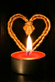 Candle and heart Stock Image