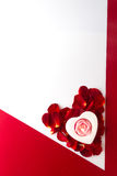 Candle heart on the heart of rose petals corner red white backgr Royalty Free Stock Photo