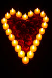 Candle Heart. A heart made of candles with rose petal Royalty Free Stock Photos