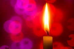 Candle on heart shapes background Royalty Free Stock Photo