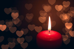 Candle with hearts bokeh Royalty Free Stock Photos
