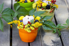 Candle holder decorated with autumn flowers Royalty Free Stock Photography