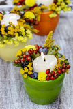 Candle holder decorated with autumn flowers Royalty Free Stock Image