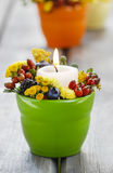 Candle holder decorated with autumn flowers Stock Image