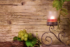 Candle holder with grapes Royalty Free Stock Image