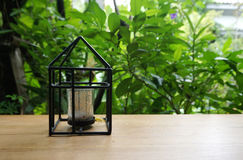 Candle holder in house shape with nature background Royalty Free Stock Photography