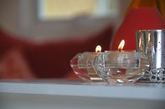 Candle holder lit on the table stock images