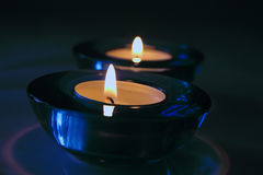 Candle holders. Candle showing shallow depth of fjield Stock Photo