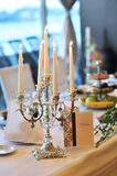 Candle holders on table Royalty Free Stock Photography