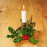 Candle and holly Royalty Free Stock Image