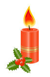 Candle with holly leaves and berries Stock Photography