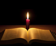 Candle and holy bible royalty free stock photo