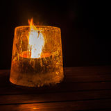 Candle in Ice Stock Photo