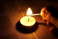 Candle ignition with match. In the evening night Royalty Free Stock Photography