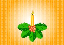 Candle with ilex Stock Photo