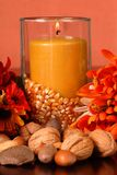 Candle In An Autumn Setting Royalty Free Stock Photos
