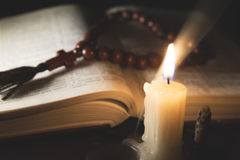 Candle with incense and holy book. Composition of candle with incense and holy book Royalty Free Stock Photos