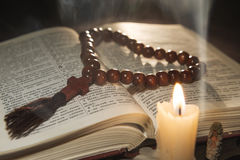 Candle with incense and holy book. Composition of candle with incense and holy book Stock Photography