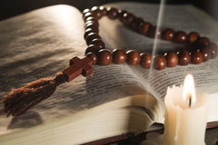 Candle with incense and holy book Royalty Free Stock Photo