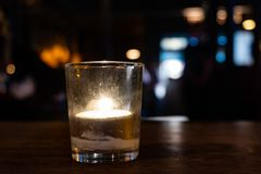 Candle in an irish pub royalty free stock photography