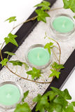 Candle and ivy leaves Royalty Free Stock Photography