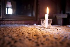 Candle on lace. At the table in coffee shop Stock Photo