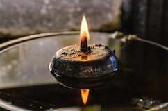 Candle lamp burning with  soft glow light Royalty Free Stock Photography