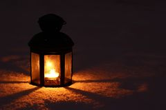 Candle lamp in snow Stock Images