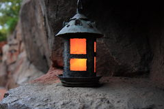 Candle lantern. On the rock Royalty Free Stock Photography