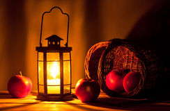 Candle lantern and apples Stock Photo
