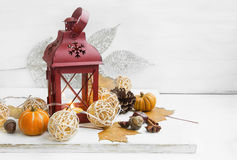 Candle lantern decoration with balls lights, pumpkins, dried lea Royalty Free Stock Image