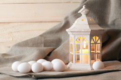 Candle lantern and eggs Stock Image