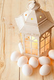 Candle lantern and eggs Stock Photos