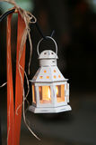 Candle lantern hanging from a hook Stock Photography