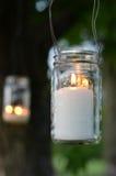 Candle lantern. Hanging mason jar lantern with white lit candle Royalty Free Stock Images