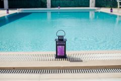 Candle Lantern Near The Pool`s Edge On A Summer`s Day, Portugal Royalty Free Stock Images