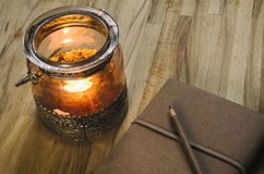 Candle lantern and a notebook Royalty Free Stock Photo