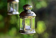 Candle Lantern. Outdoor metal candle lantern decorated with stars royalty free stock photos