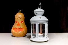 Candle lantern with pumpkin Stock Images