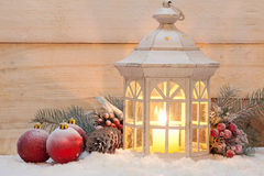 Candle lantern in snow Royalty Free Stock Images