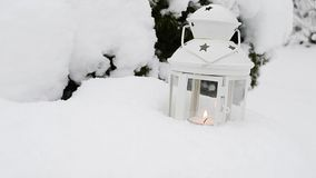 Candle lantern in the snow stock footage