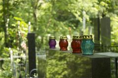 Candle lanterns on tomb stones in graveyard in summer stock photography