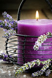 Candle with lavender flowers Stock Images