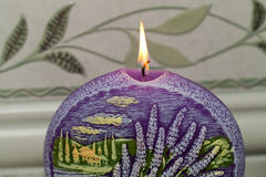 Candle with lavender flowers. Stock Image