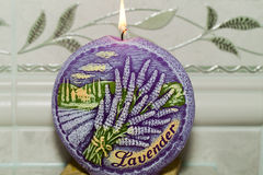 Candle with lavender flowers. Stock Photography