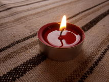 Candle. Leave in the brightness Stock Photo