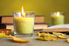 Candle. With leaves and books on wooden background Stock Image