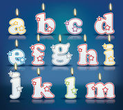 Candle letters from a to m Stock Photo